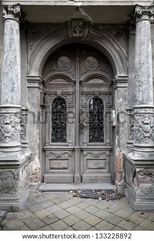 Old entrance door on historic building