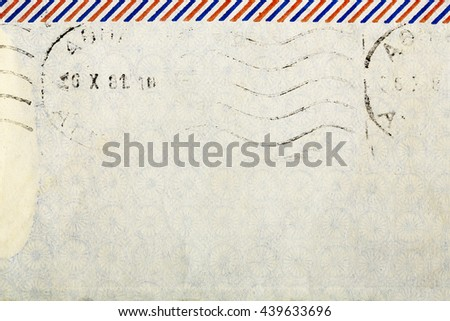 old envelope with post mark for background use - stock photo
