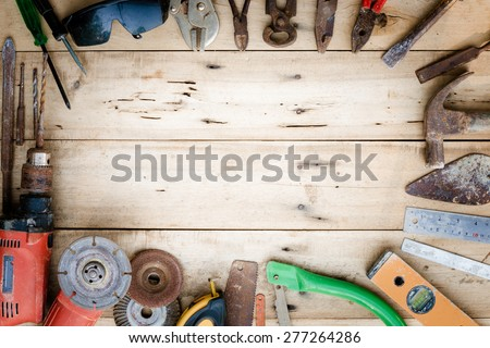 old equipment tools set on wood - stock photo
