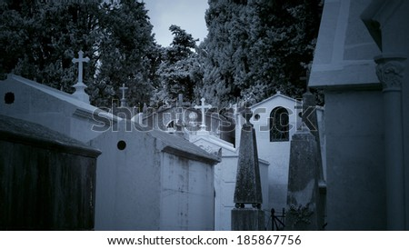 Old European cemetery. Infrared toned blue. - stock photo
