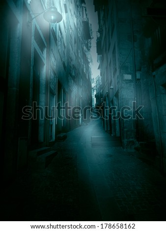 Old European narrow street in a foggy dawn (personal perspective) - stock photo
