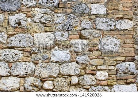 Old european wall from the Tuscany region of Italy - stock photo