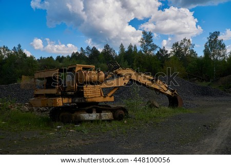 Old excavator in a basalt stone quarry.