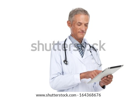 Old experienced doctor reading diagnose. Standing isolated on white