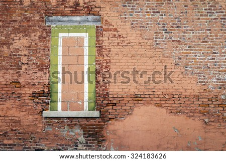Old Exterior Brick Wall with Filled Window Opening
