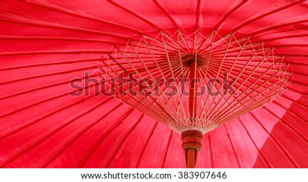 Old fabric red umbrella structure which is thai style. It can be used as a background