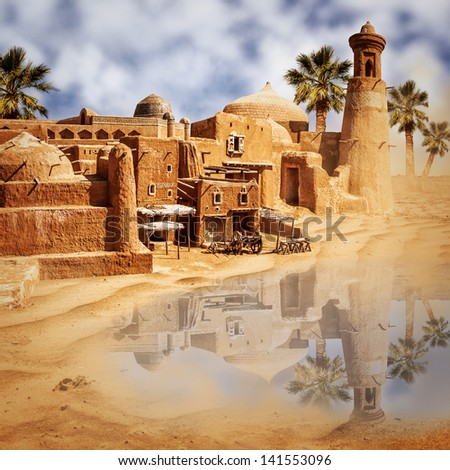 Old fabulous city and lake in the desert - an oasis mirage - stock photo