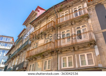 Old facade building in downtown Porto. - stock photo