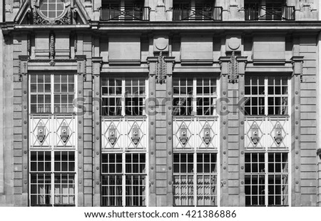 Old facade exterior detail with monochrome color scheme - stock photo