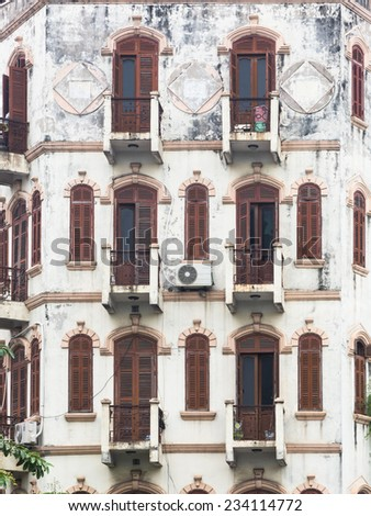 Old facade of a colonial building in Hanoi, the capital city of Vietnam