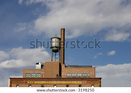 old factory and water tower - stock photo