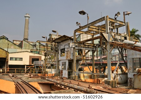 Old factory building structure with colorful exterior. - stock photo