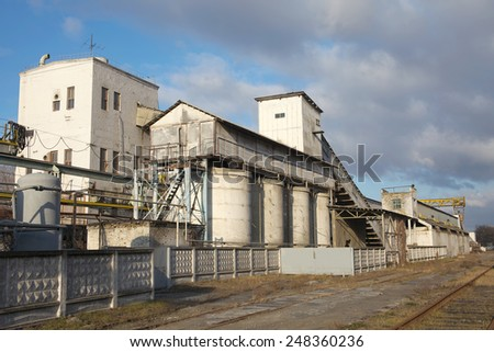 Old factory in the city industrial zone - stock photo