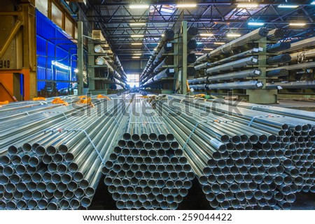 Old factory of auto components production. Warehouse of an aluminum pipes - stock photo