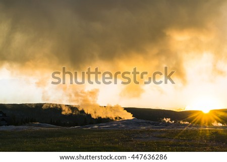 Old faithful on the sunset,summer, in Yellowstone National park,Wyoming,usa. - stock photo