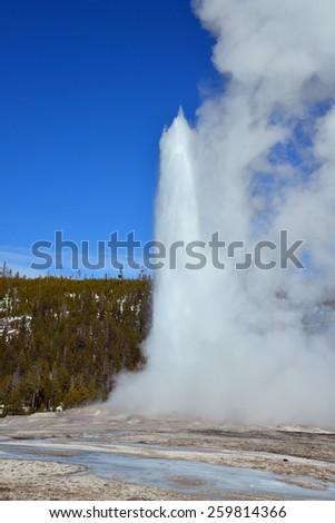 Old Faithful Winter Time Yellowstone National Park - stock photo