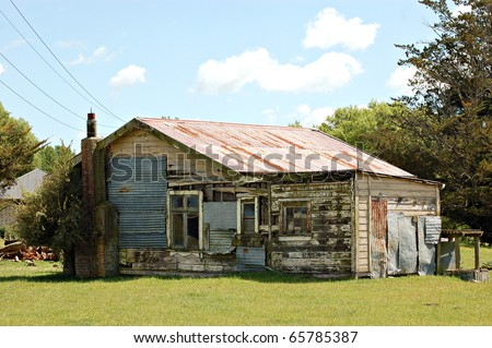 Old farm cottage - stock photo
