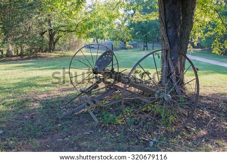 Old Farm Equipment in Pasture - stock photo