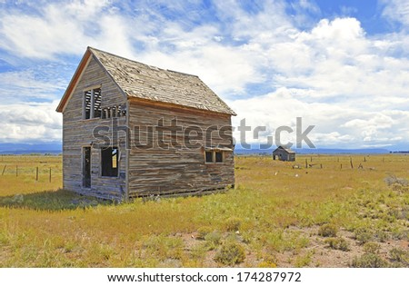 Old Farm House in Rural Landscape, Western USA - stock photo