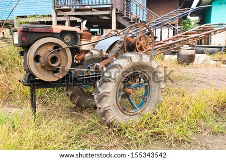 old Farmer tractor in thailand - stock photo