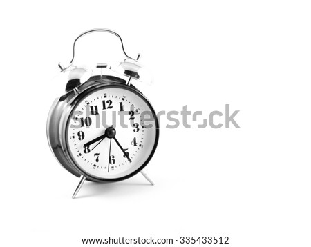 Old fashion alarm clock on white background - stock photo