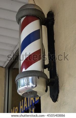 Old fashion barber shop pole background - stock photo