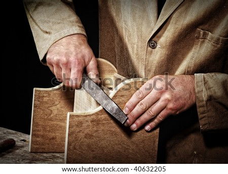 old fashion craftsman at work fine closeup detail background - stock photo
