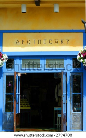 old fashion drug store with apothecary sign - stock photo