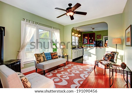 Old fashion living room with antique couch. View of kitchen room - stock photo