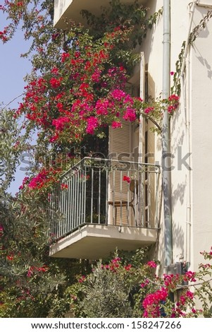Old-Fashion Mediterranian Balkony with pink Flowers