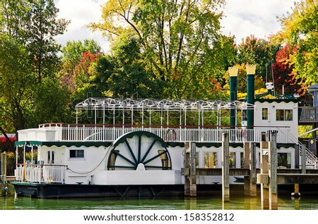 old-fashion steamer docked in a marina in autumn - stock photo