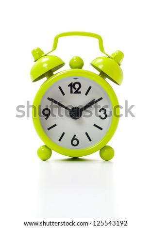 Old fashioned alarm clock isolated on white background. - stock photo