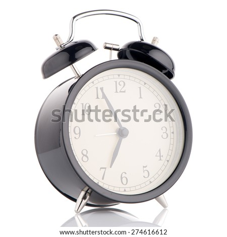 Old fashioned alarm clock on white background. - stock photo