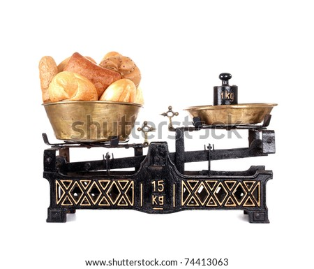 Old-fashioned balance scale with breads  isolated on white background - stock photo