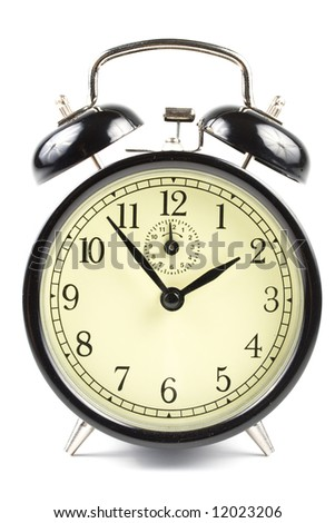Old-fashioned black alarm clock isolated on a white background - stock photo