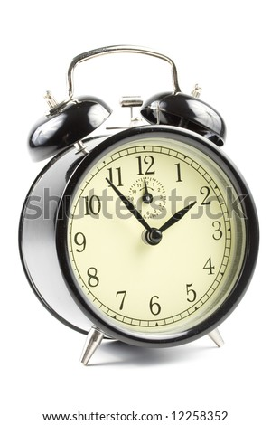 Old-fashioned black alarm clock isolated on a white background