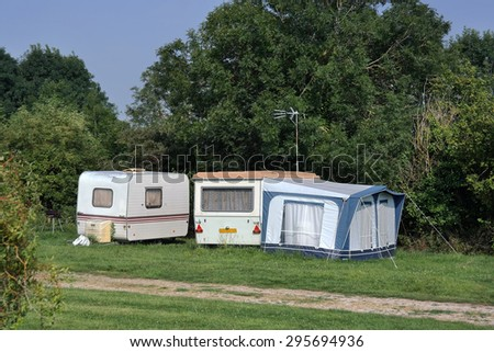 Old-fashioned caravans at farmers campsite in Normandy, France - stock photo