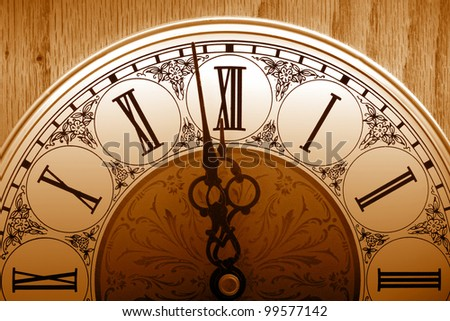 old fashioned clock about to hit 12 midnight - stock photo