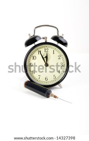 Old fashioned clock with syringe - stock photo