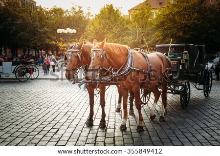 Old-fashioned Coach At Old Town Square in Prague, Czech Republic. - stock photo