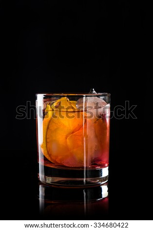 Old fashioned cocktail on the black background - stock photo