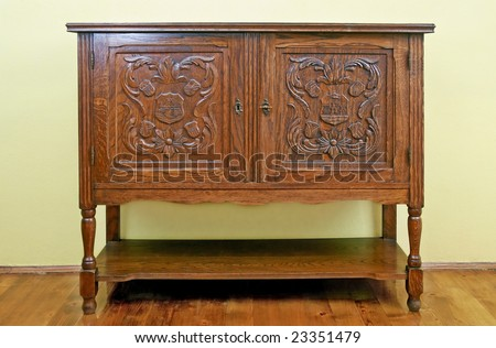 Old fashioned dresser with ornate doors - stock photo