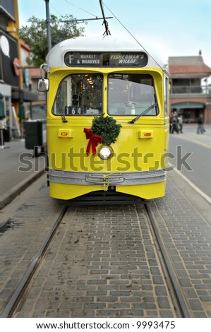 Old fashioned electric trolley car in San Francisco near Fisherman's Wharf. - stock photo
