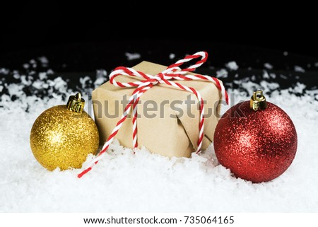 old fashioned gift wrapped in plain paper tied with red and white twine sitting in - Old Fashioned Paper Christmas Decorations
