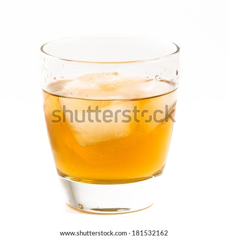 Old fashioned glass with whisky on the rocks served - stock photo