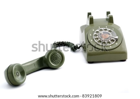Old fashioned green telephone - stock photo