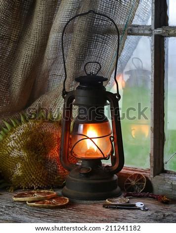 Old fashioned kerosene lantern style oil lamp. - stock photo