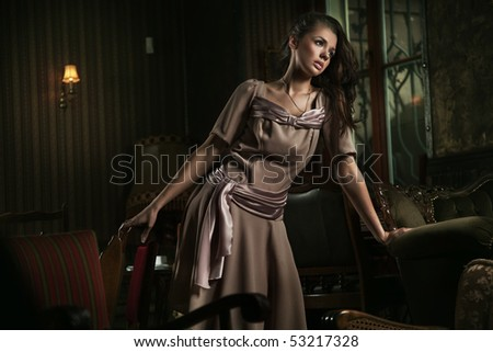 Old fashioned lady posing - stock photo