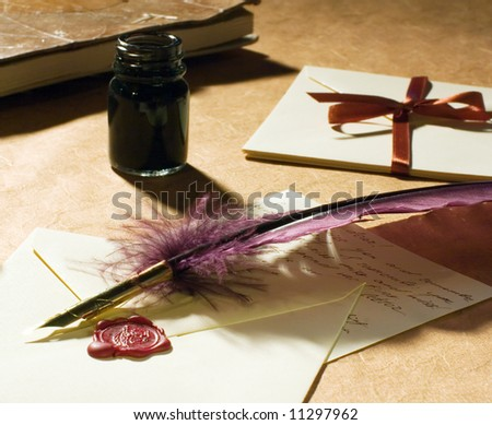 old-fashioned letters with a quill, an inkwell  on a rustic paper. - stock photo