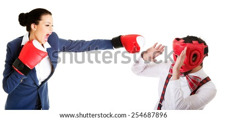 Old fashioned man defending against angry woman's stroke. - stock photo